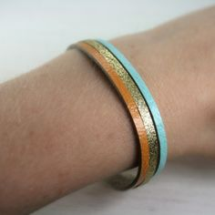 leather bracelet in orange aqua and glittery gold by tinygalaxies