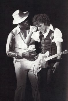 Bruce Springsteen and Clarence Clemons having some fun on stage.