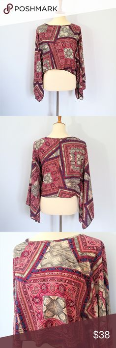 "Vestique Patterned Cropped Poncho Style Top size S Excellent pre-loved condition with no holes, stains or flaws. Beautiful poncho style top with unique paisley/graphic print.  Underarm to underarm measures 22""  Same day or next business day shipping. Offers welcomed & bundles always discounted. ""Like"" my items for private flash sales! Vestique Tops"