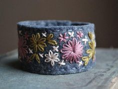 Felt Bracelet Cuff Hand Embroidered Grey Wool Felt with Old Rose, Pale Pink and Gold Embroidery by love maude Felt Bracelet, Denim Bracelet, Fabric Bracelets, Handmade Bracelets, Bracelet Making, Cuff Bracelets, Handmade Jewelry, Felt Embroidery, Hand Embroidery Designs