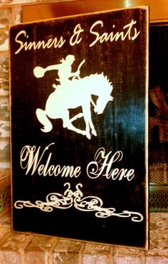 Hey, I found this really awesome Etsy listing at http://www.etsy.com/listing/92655334/rustic-welcome-sign-sinners-and-saints