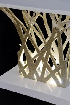 Illuminated table base. Design by Paul Vu. Fabrication by Sterling Surfaces. Photo by Jeff Baumgart.