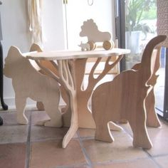 a table shaped like a tree! chairs with animal profiles for the sides I want the elephant chair for myself! If you can draw or trace simple outlines, are good with a jigsaw, and have patience, I think this could be a DIY project.