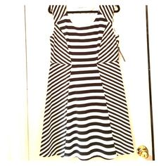 NY&Co Black & White Stripe Dress NY&Co black & white A-line striped soft dress. Polyester/spandex blend. Top part lined inside. Cap sleeve. Flowy, flirty, and the way the seams fall makes this dress super flattering! Would keep but not my size!! New York & Company Dresses Midi