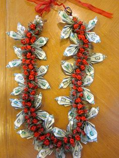 Graduation or birthday or mothers day Money Lei with bills Money Lei, Orange Flowers, Silk Flowers, Coach Appreciation Gifts, Graduation Leis, College Graduation, Arts And Crafts, Paper Crafts, Baby Wedding
