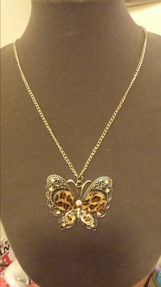 $5 deal! https://www.etsy.com/listing/197442569/leopard-butterfly-necklace