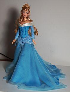Walt Disney´s Sleeping Beauty Aurora OOAK doll. She has a full facial repaint, a new hairstyle, handsewn gown and custom made juwels. Base doll: Mackie Barbie