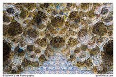 Ceramic tiles ceiling decorating a muqarnas vault at Nasir al-Mulk Mosque. Photo: Quintin Lake