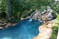 pool with slide waterfall grotto cave... omg this would be so fun! and look at the fire pit! ahhh want!