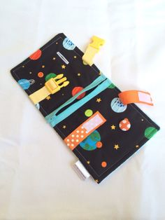 Space Busy blanket - a buckle, snap, zip, Velcro, and button toy - fine motor skills practice on Etsy, $30.00