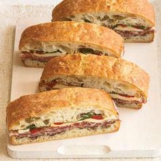 """Pressed Italian Sandwiches - These hearty sandwiches pack beautifully for toting along on a picnic or to the beach. Prep Time: 20 minutes, plus at least 30 minutes of \""""pressing\"""" time..  Print this recipe at AmericanFamily.com."""