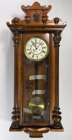 Lot 189: Gustov Becker Mahogany Wall Clock; 20th Century, stamped mark to the face; including key and pendulum