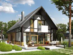 Dużym atutem projektu są wielkoformatowe przeszklenia, dzięki którym dom jest wypełniony naturalnym światłem a salon harmonijnie łączy się z przestrzenią tarasu.