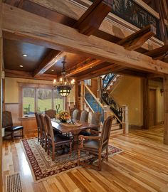 The reclaimed oak timbers in a Batavia, NY home support the loft above and offer intimate dining space below.Photo by Don Cochran Photography.