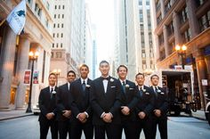 Handsome groomsmen in black and white tuxedos, traditional Chicago wedding.