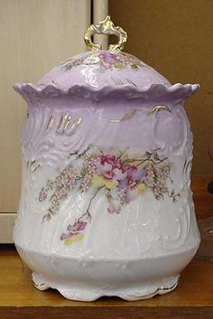 Pretty - We would call it a cookie jar or even use it for loose tea, but the British would call it a biscuit jar.