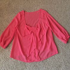 Pink chiffon bow top size medium The bow is on the back of the top, it's chiffon so it's see-thru as shown in the pic. Brand new, never worn - would look adorable with black skinny jeans or denim and boots  Oboe Tops Blouses