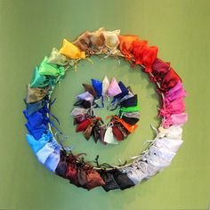 Satin fabric bags wreath made of a rainbow of colors. #asdmarketweek #lasvegas #papermart