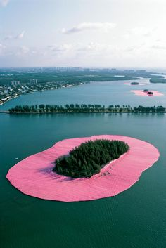 Christo and Jeanne-Claude, Surrounded eleven islands with pink polypropylene floating fabric in Miami's Biscayne Bay, 1983.