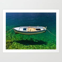 Boat floats on crystal clear water of Symi island, Greece Art Print by kostaspavlis Greece Art, Water Art, Crystal Clear Water, From The Ground Up, Buy Frames, All Over The World, Gallery Wall, Boat, Island