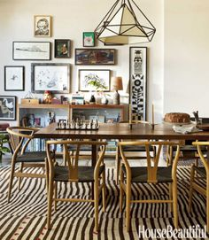 """A beloved dining table was resized by its maker, Alma Allen, to fit the dining room in this Los Angeles house. """"It's been with them forever, which we love,"""" says designer Pamela Shamshiri. Hans Wegner's Wishbone chairs pick up on the Asian sensibility. Hanging lantern from Lawson-Fenning. Vintage patchwork rug from Lawrence of La Brea."""