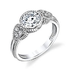 925 Sterling Silver 2 Carat Brilliant Round Center CZ Simulated Diamond Engagement Promise Ring with Heart Accents on the sides #SOE007 Minxwinx http://www.amazon.com/dp/B0106X3JSK/ref=cm_sw_r_pi_dp_71QTwb04ARDGA