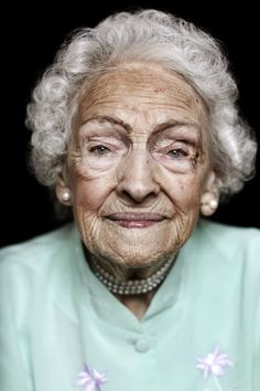 Photography by Mark Taylor. I love pictures of old faces.  This photo works well for me. I love the feel to this photo and how this lady still likes to feel glamorous no matter what age. The eyes have maintained strong with little sagging. The mouth however has slight wrinkles even with fantastic lips that do not look too frale.