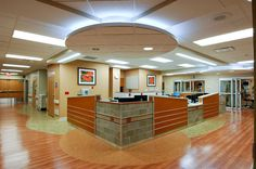 Like the variety of the earthy colors; the pattern on the floor and the lower ceiling on the information desk