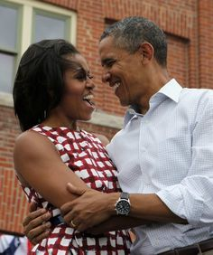 First lady Michelle Obama and U.S. President Barack Obama hug on stage before he speaks at a campaign event at the Alliant Energy Amphitheater in Dubuque, Iowa, August 15, 2012. [Reuters Pictures]
