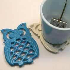 Cream & teal cast iron owl coasters / trivets, $18 ... Etsy!