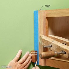 Use a Block of Wood for Scribing Find the largest distance between the outside of the cabinet and the wall. Take that measurement and make a pencil mark on your filler strip (measure over right to left in this case).
