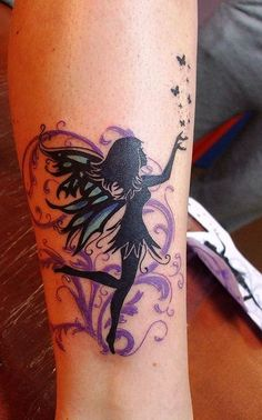 Nice black fairy with purple patterns tattoo