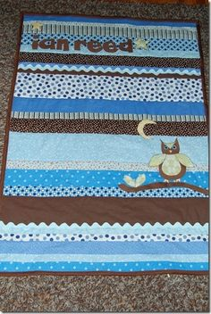 Baby quilt; strips, ricrac, applique. Cute!