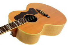 We have a beautiful pre-owned 2002  J-185 acoustic guitar here for sell. It's in excellent condition and  comes with a non-original hardshell case. The first Gibson J-185 was introduced  in 1951, giving players a broader choice of flat-top acoustic guitars.  It quickly became a hit. With a slightly smaller body than Gibson's  fabled Super Jumbos, the J-185 offers an excellent alternative for  players seeking a smaller body style without sacrificing acoustic power  and projection.