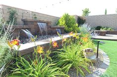 A three tiered water feature using Atlantic Water Gardens sheer decents adds such a great focal point in your landscape. These are unique in that they are colored by LED bulbs. There are three colors to chose from or you can have a feature that cycles through the rainbow.