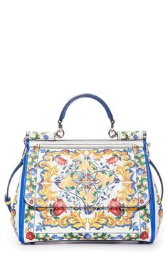 Dolce&Gabbana's signature Mallorca print adds Italian flourish to an impeccably crafted satchel in textured white leather. Designed with a spacious interior and signature mirror pocket, this versatile bag features a top handle for toting and a removable strap for over-the-shoulder wear.