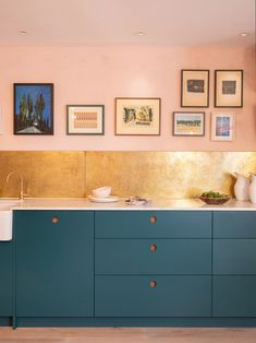 The Kitchens of the Moment Have a Midas Touch. Or there's the subtle route: just swap your backsplash for brass sheets, like this room by Naked Kitchens. It not only elevates the super-simple blue cabinets, but complements the warm, peachy walls too. Kitchen Buffet, Brass Kitchen, Green Kitchen, Kitchen Shelves, Kitchen Colors, New Kitchen, Kitchen Ideas, Metal Kitchen Backsplash, Pink Kitchen Walls