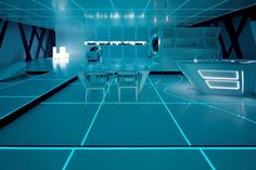 a movie-influenced design show by disney and DuPont, the presentation translates the set of the recent release of TRON into an installation of living solutions designed in Corian.