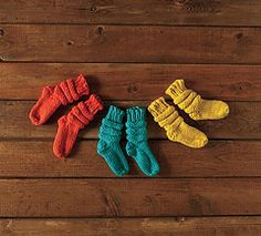 These simple baby booties are knit from the toe up and use a short row heel created by either Wrap & Turn or Twin Stitches, directions for both are included. the pattern on the leg is made by repeating a series of knit and purled rounds.