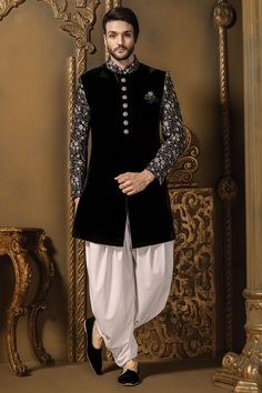 Buy Samyakk Black & silver velvet ravishing sherwani online in India at best price.Black & silver velvet ravishing sherwani with pearl white cotton silk dhoothi which makes the wearer Sherwani For Men Wedding, Wedding Dresses Men Indian, Sherwani Groom, Mens Sherwani, Wedding Dress Men, Wedding Suits, Gents Wedding Wear, Indian Weddings, Trendy Wedding