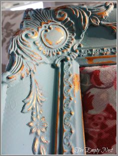 DIY: Painted & Crackled Frame Tutorial - this was distressed with a damp rag, instead of sandpaper.