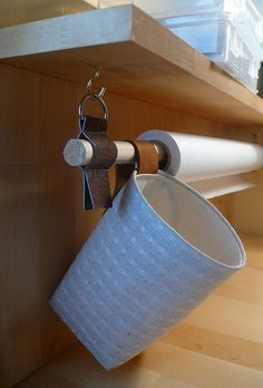 hang wrapping supplies from a dowel suspended from EZ-Up frame