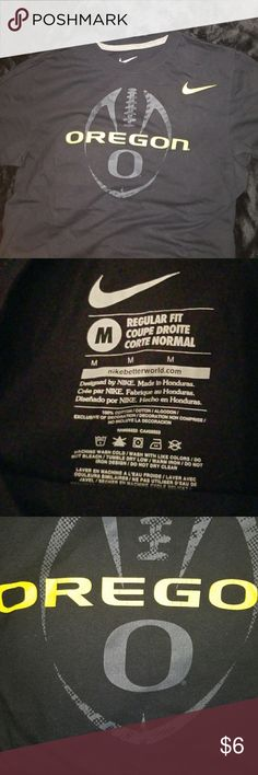 Nike Oregon Ducks tee medium Size medium.  Worn and washed once.      Regular fit tee.   See pic of tag.     No stains.  Slight cracking in the Oregon.   See pics.  Took pics with and without flash.    Comfy tee.  Pet and smoke free home  **Add to a bundle *** Nike Tops Tees - Short Sleeve