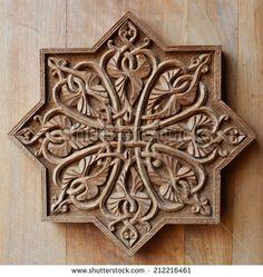 Ornament on wooden door - stock photo