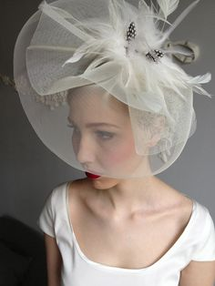 Model Josephin wearing a vintage wedding hat we found at the flea market.
