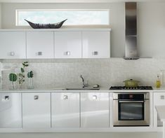 Crosse Thermofoil Gloss Lilly. Crisp, contemporary lines and just the right white make this kitchen perfect for those who enjoy the urban life, or desire contemporary décor. The sleek styling and city views pair well together to create just the right atmosphere for entertaining.