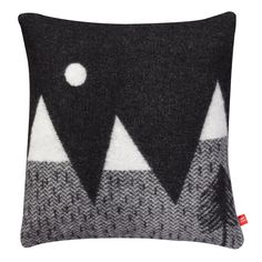 This super soft and cosy cushion is the perfect couch companion on a cold winter's night. 100% soft lambswool, woven in Scotland. Comes with a duck feather
