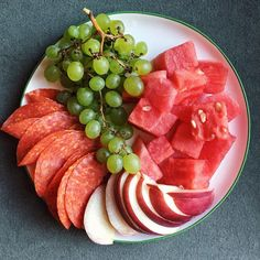 280-I have way too much fruit at home, so breakfast is a plate of watermelon, grapes, white peach, and pepperoni for protein.