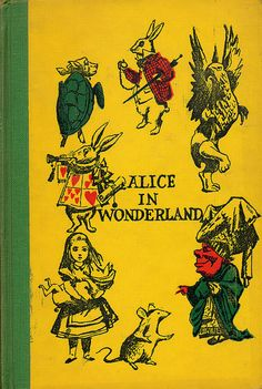 Alice In Wonderland  Alice In Wonderland  Written by Lewis Carroll. Illustrated by A.E. Jackson.  Junior Deluxe Editions, 1954.