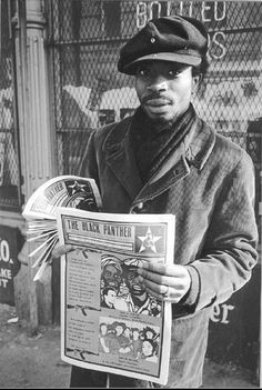 A member of the Black Panther Party sells the paper on the streets of Oakland, 1970